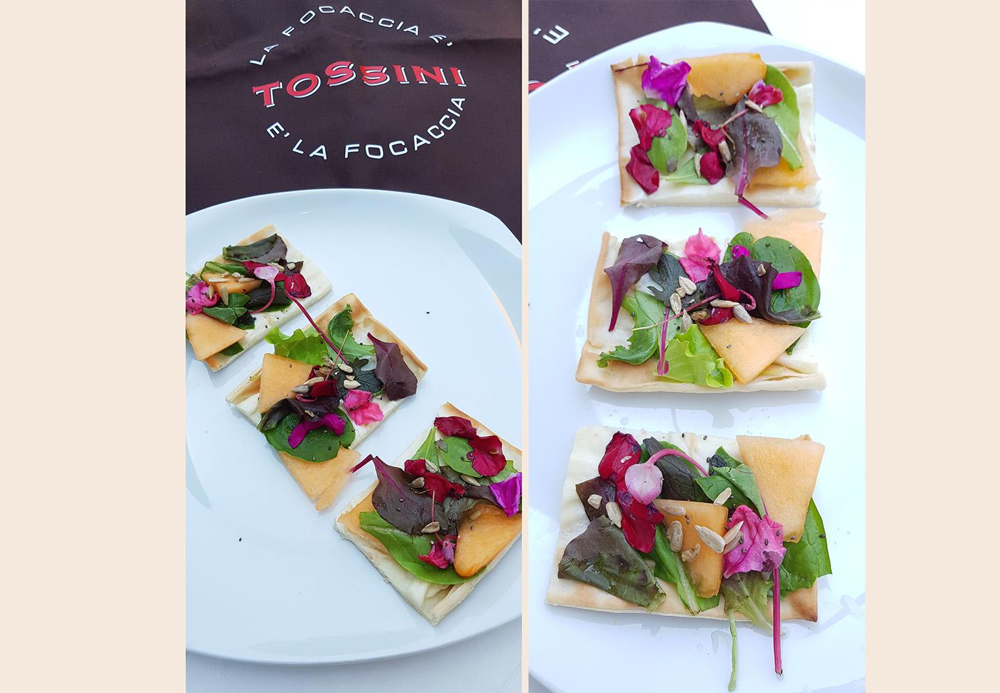 Focaccia col formaggio con insalatina, melone, semi di girasole e fiori eduli - Tossini